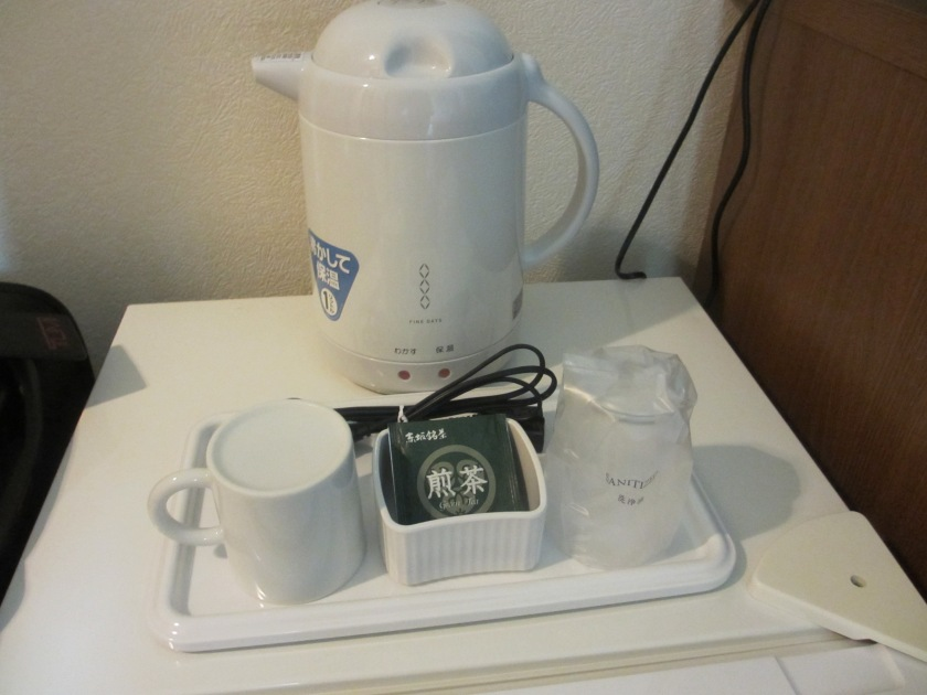 The room is tiny, but they still prepared a hot water pot, tea and cups! Yep, definitely the motherland